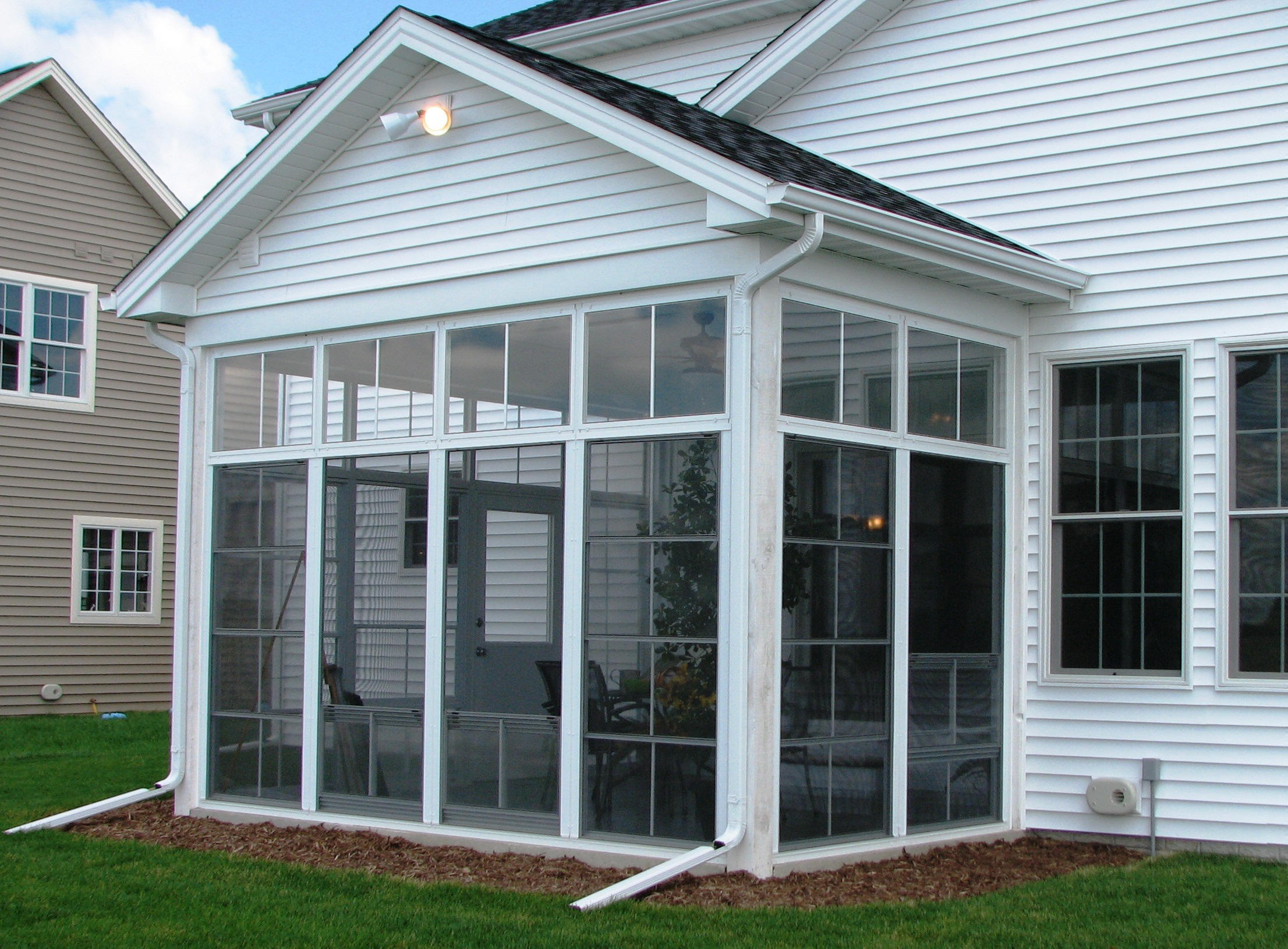 4 Track Stackable Vinyl Windows with fixed transoms