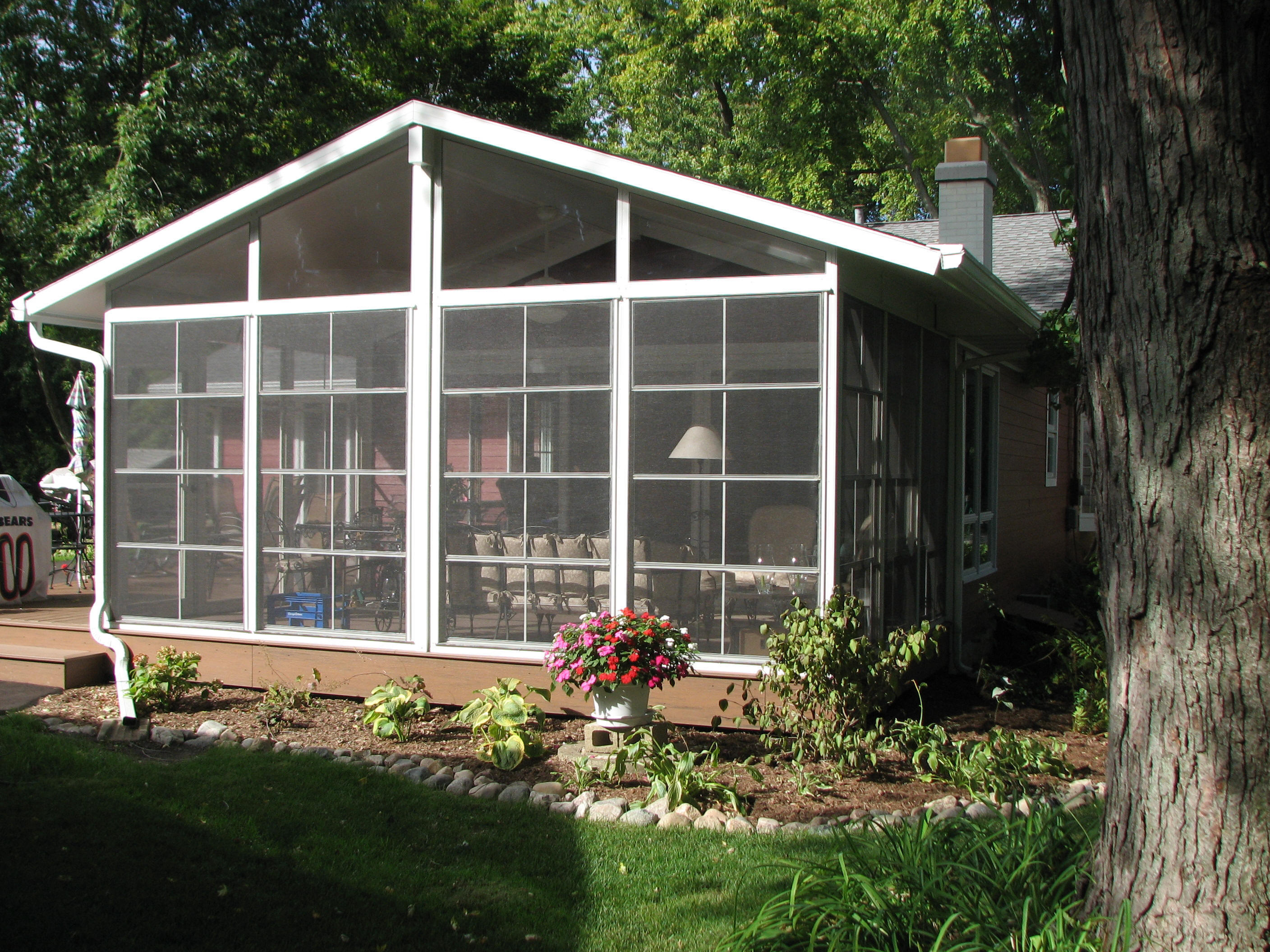 4 Track Stackable Vinyl Windows with trapezoid transoms